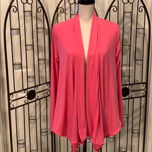Pink polyester cardigan w/long front & short back.